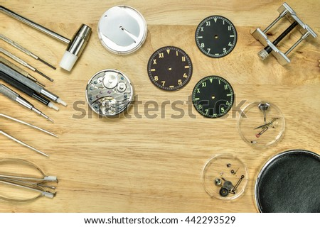 Watch repair tools and watchmaker tools on wood table , Top view - stock photo