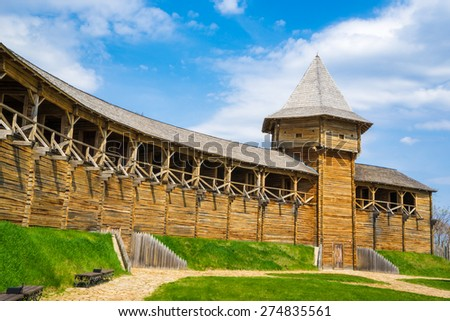 Watch tower and outer wall of the Baturin Citadel - wooden cossac's fortification. Baturin, Ukraine. - stock photo