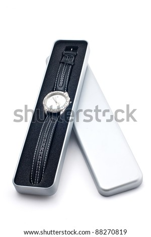 Watch with a black leather thong in a case, isolated on a white background.