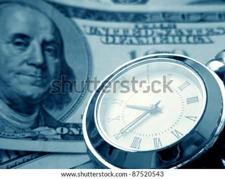 Watches on a dollars in blue tone. Business concept. - stock photo