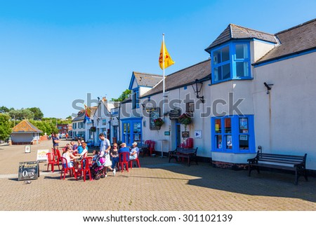 WATCHET, ENGLAND - JULY 09, 2015: street view with unidentified people in Watchet, that is a harbour town, civil parish and electoral ward in the English county of Somerset, with a population of 3,785 - stock photo