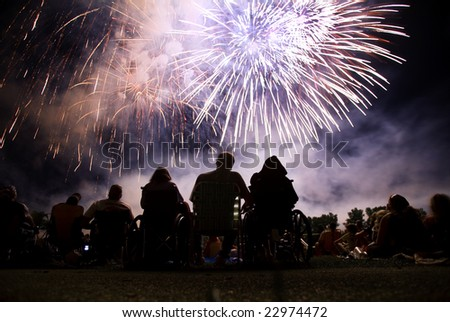 Watching a fourth of July fireworks display. - stock photo