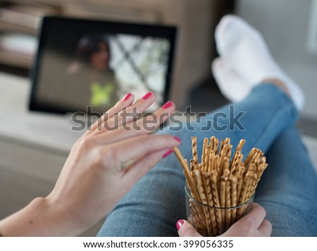 Watching the TV series on a digital tablet - stock photo