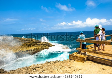Watching the waves smash on to the shore in Curacao - stock photo