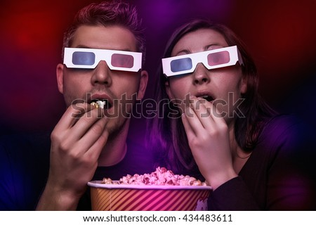 watching thriller in 3d - stock photo