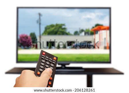 Watching TV and using remote controller isolated on white. selective focus - stock photo