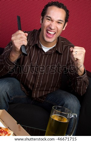 Watching TV with Beer and Pizza - stock photo