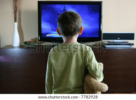 watching TV with sweet teddy bear - stock photo