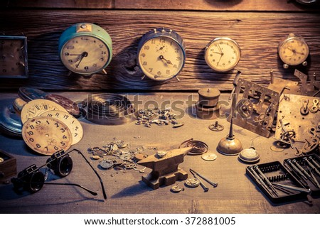Watchmaker's room with parts of clocks - stock photo