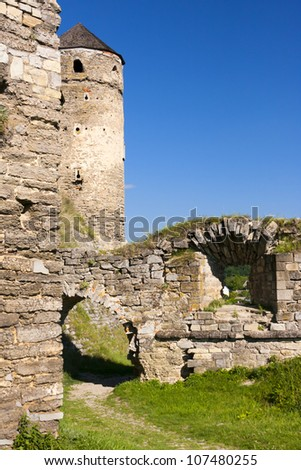 Watchtower and the surrounding walls of the old Fortress (in Kamenets-Podolskij, Ukraine). - stock photo