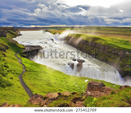 Water abyss. Enormous waterfall Gyullfoss. Summer in Iceland - stock photo