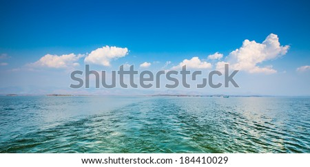 water after boat with blue sky - stock photo