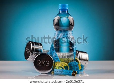 water and  fitness equipment  composition - stock photo