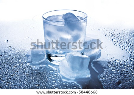 water and ice with puring water - stock photo