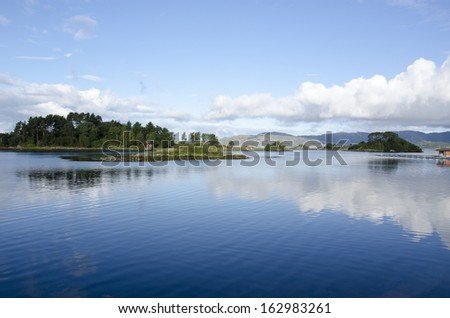Water and lake with islands and clouds, ocean around Bergen in Norway - stock photo