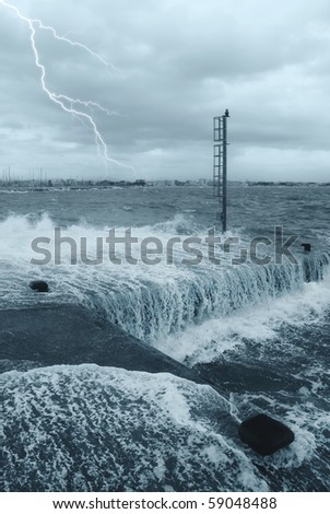 water and lightning on the pier - stock photo