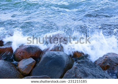 Water and rocks - stock photo