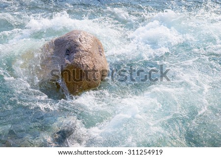 Water and stone. A fragment of the mountain river or the sea. - stock photo