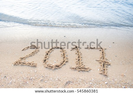 Water back to the sea 2017 appear by written form me, Sand beach flooded with sea water as a background,happy new year