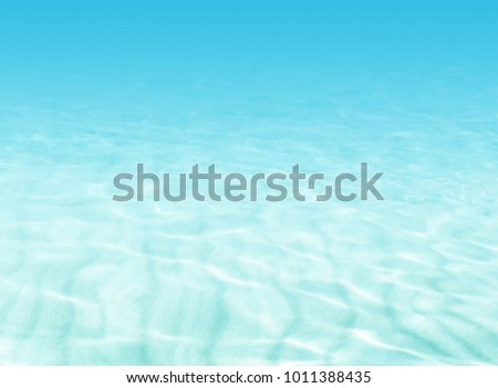 Water background - beach scene - soft blue underwater ocean - summer holiday concept
