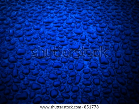 Water beading on the hood of a freshly waxed vehicle. - stock photo