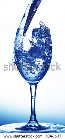 Water being poured into a wine glass