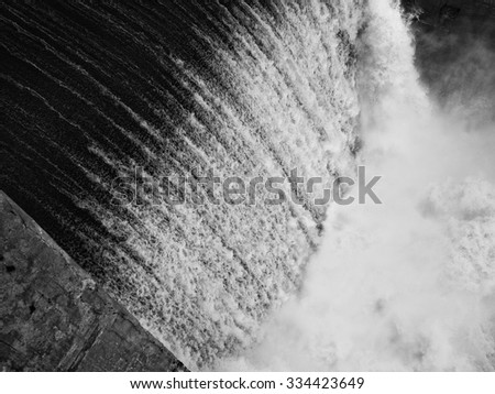 water being released from a dam, black and white version - stock photo