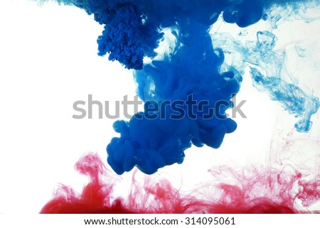 Water blue and red ink against a white background - stock photo