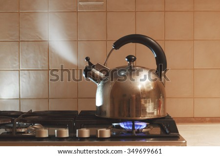 water boils in the kettle - stock photo