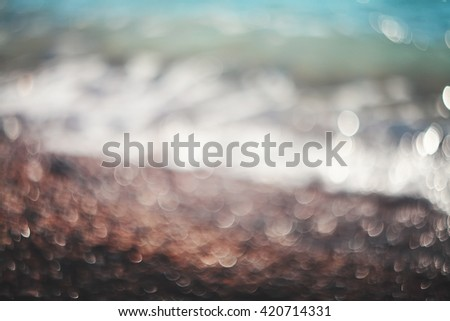Water bokeh lights on the coastline.Natural background. - stock photo