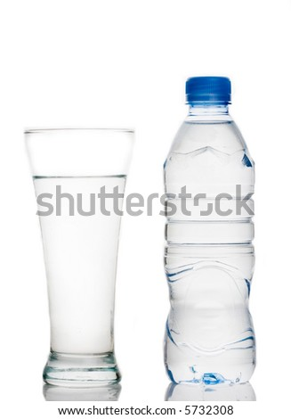 Water bottle and a glass of water against white background - stock photo