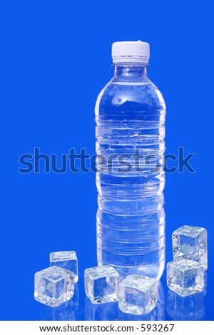 Water bottle and ice cubes on blue background. - stock photo
