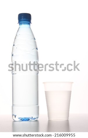 water bottle and plastic cup - stock photo