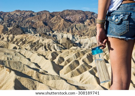 Water Bottle and the Desert - stock photo
