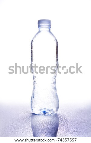 water bottle isolated on white shot in high key copy space in center of bottle with reflection and water droplets - stock photo