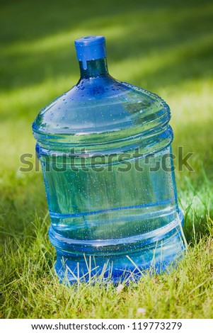 water bottle on green lawn background - stock photo