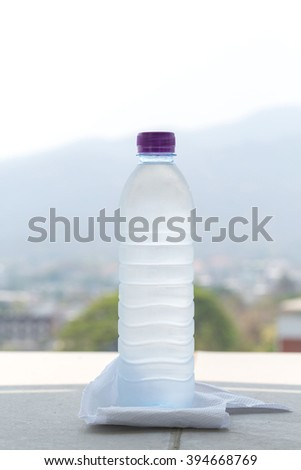 Water bottle on mountain background - stock photo