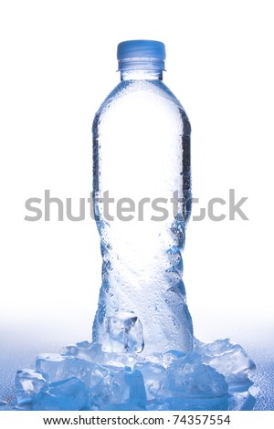 water bottle on white shot in high key copy space in center of bottle with ice, reflection and water droplets in gradient, cool blue tone - stock photo