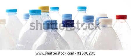 water bottle stack closeup on white background - stock photo