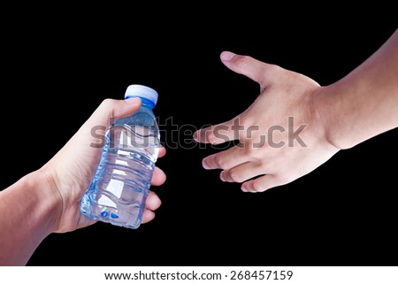 Water bottle with Hand on black Background - stock photo