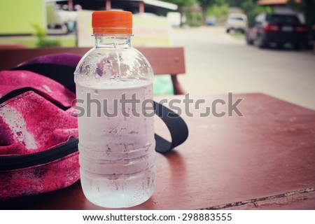 Water bottle with sports bag  - stock photo