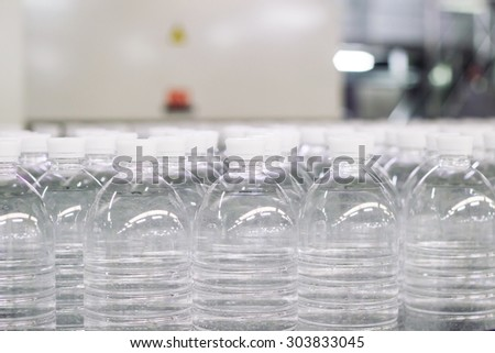 Water bottles on a filling line .Factory. - stock photo