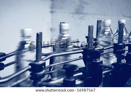 water bottles traveling along a production line - stock photo