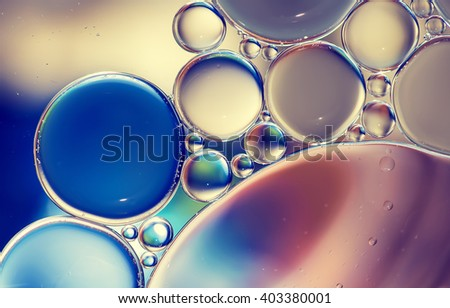 Water bubbles colorful macro abstract as background - stock photo