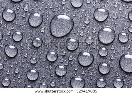 Water bubbles on black surface texture. - stock photo
