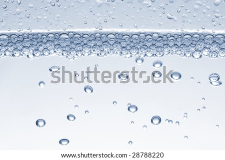 Water bubbles rising to the surface. - stock photo