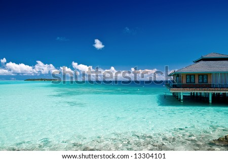 Water Bungalow on an maldivian island in the indian ocean - stock photo