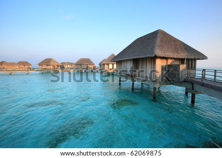 Water bungalows in turquoise sea at maldives - stock photo