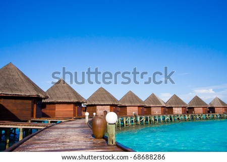 Water bungalows of hotel on the tropical island of Maldives