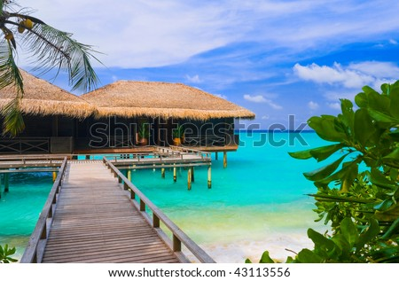 Water bungalows on a tropical island - travel background - stock photo